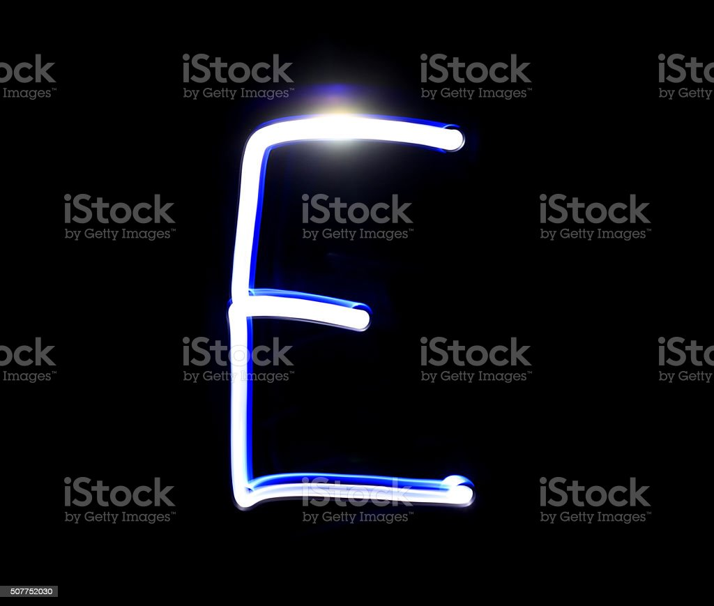 E Easy alphabet hand writing blue light  over black background. stock photo