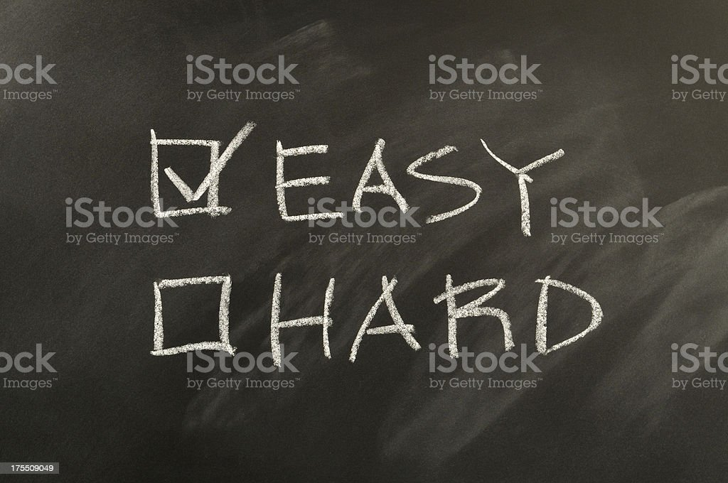 Easy and Hard Checkbox Written on Blackboard stock photo
