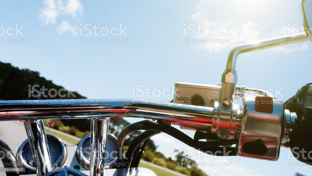 Easy rider: view over handlebars of motorbike stock photo
