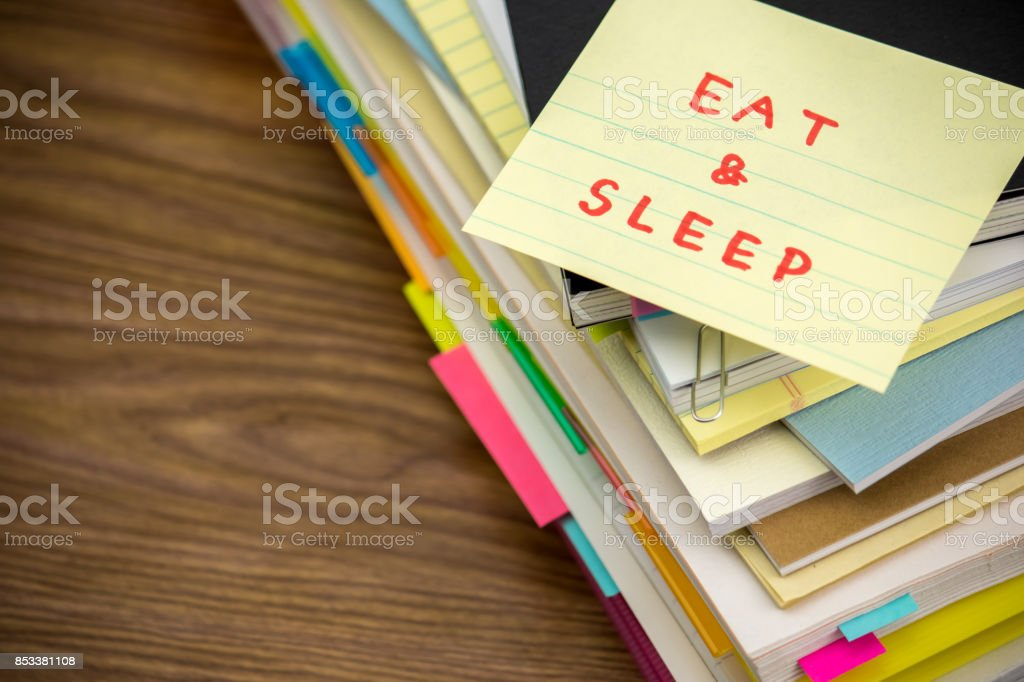 Eat and Sleep; The Pile of Business Documents on the Desk stock photo