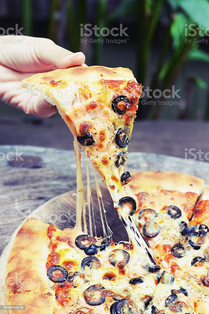 eat pizza stock photo