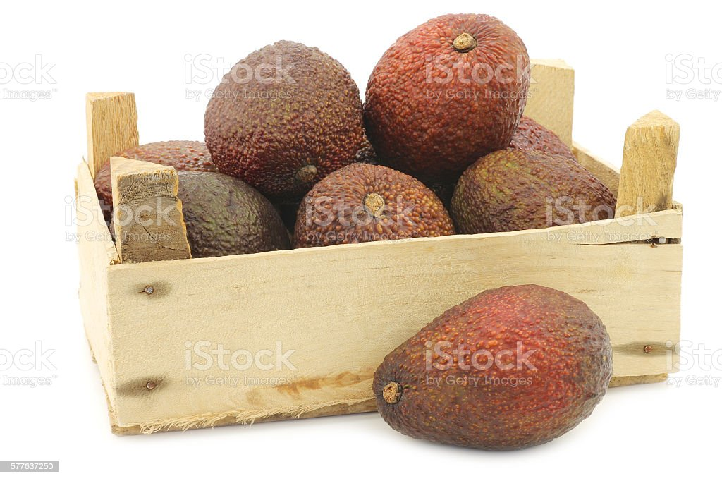 Eat ripe avocado's in a wooden crate stock photo