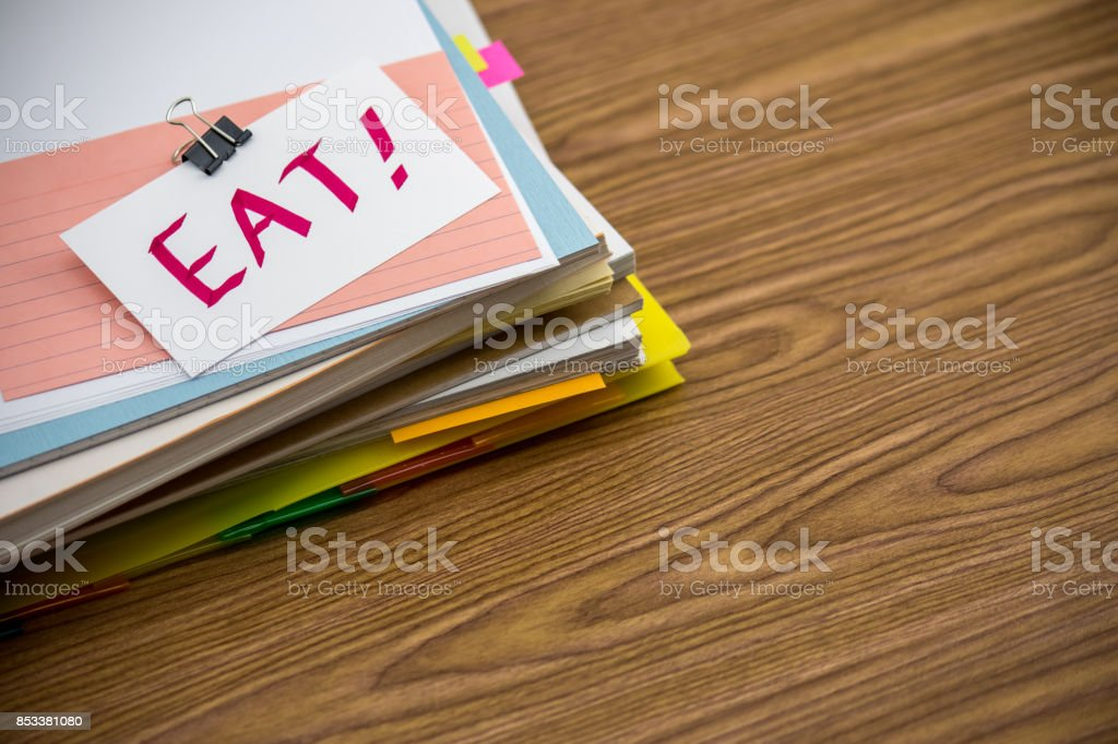 Eat; The Pile of Business Documents on the Desk stock photo