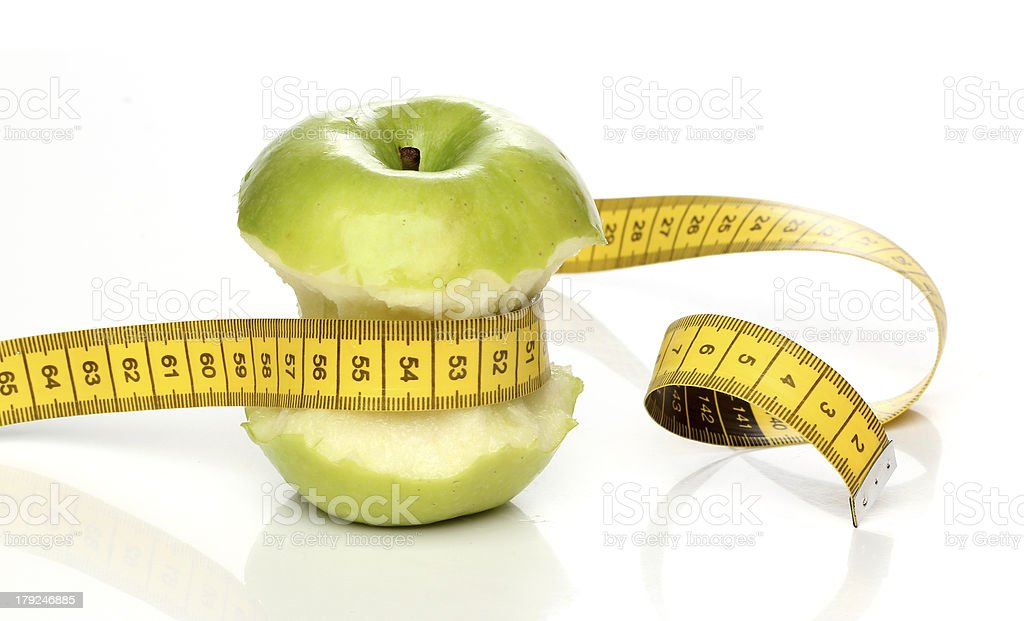 Eaten green apple and a measuring tape isolated royalty-free stock photo