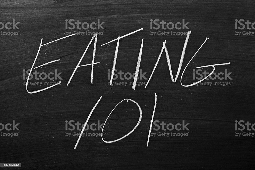 Eating 101 On A Blackboard stock photo