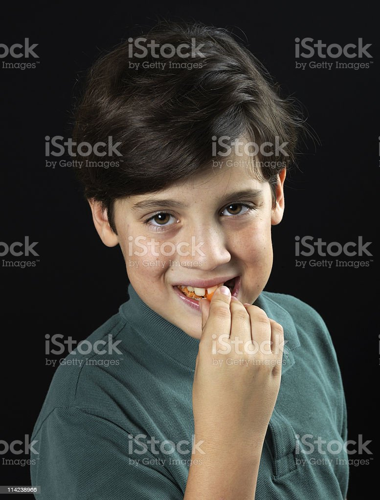 Eating a carrot stock photo