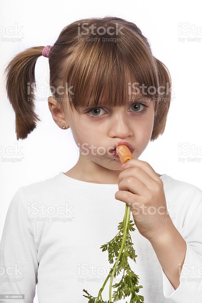 Eating a carrot royalty-free stock photo