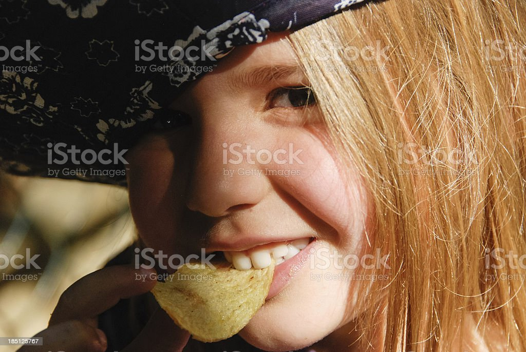 Eating a chips stock photo
