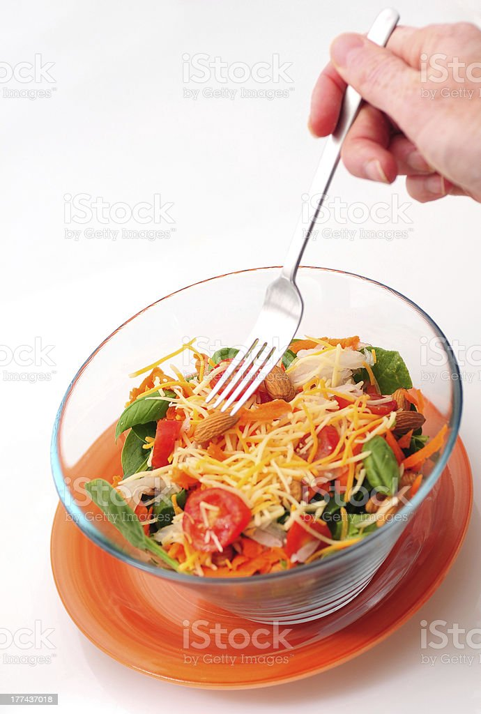 Eating a healthy bowl of salad with fork royalty-free stock photo