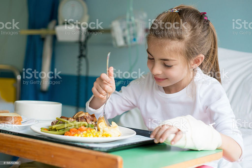 Eating a healthy meal in the hospital stock photo