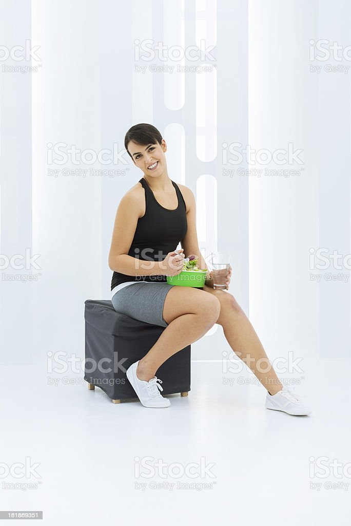 Eating a healthy salad after workout royalty-free stock photo