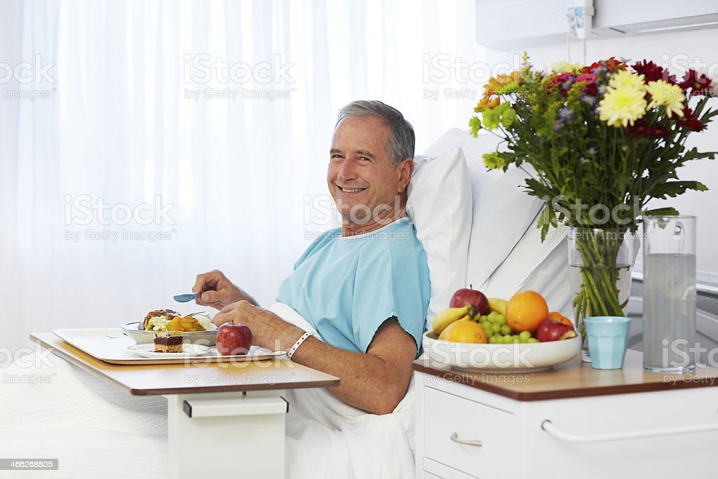Eating a hearty meal to speed up his recovery royalty-free stock photo