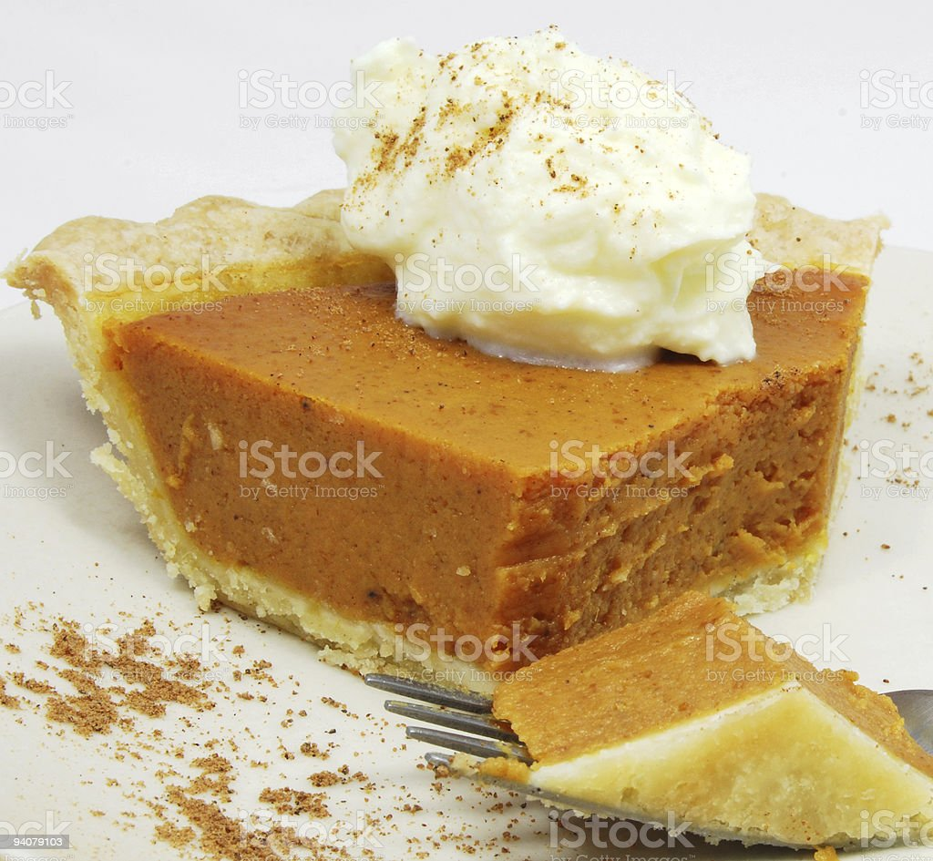 Eating a Slice of Pumpkin Pie stock photo