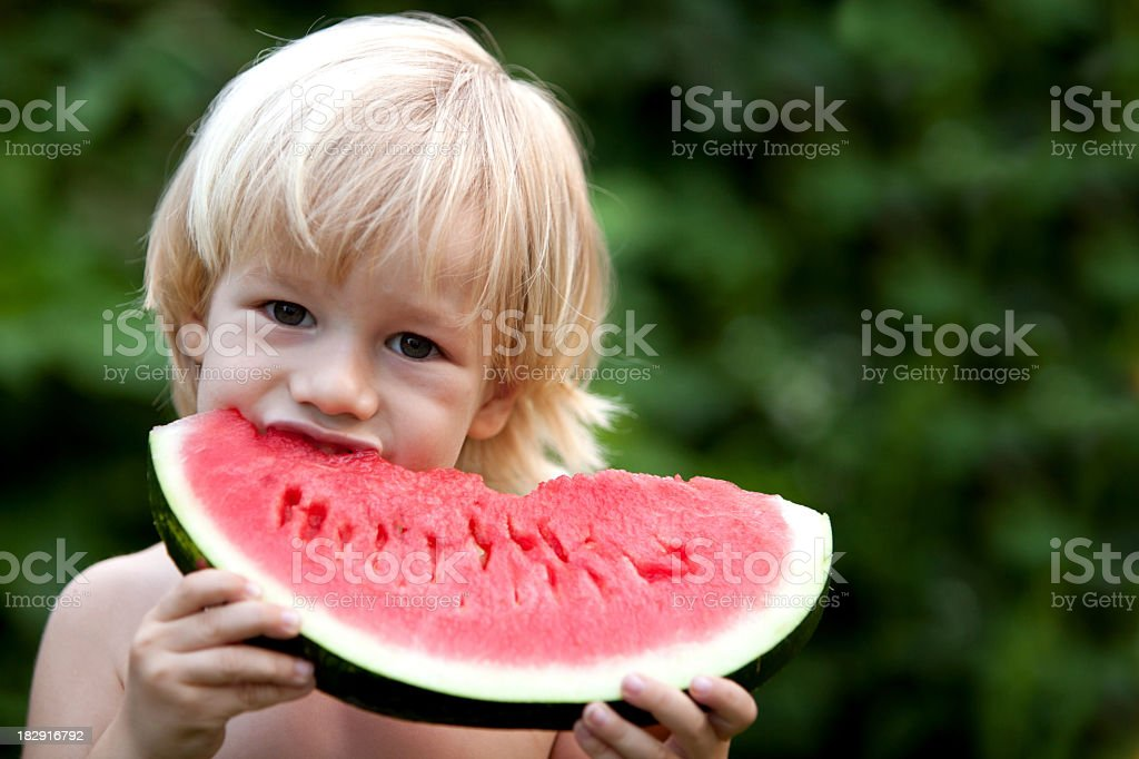 Eating a sweet watermelon royalty-free stock photo