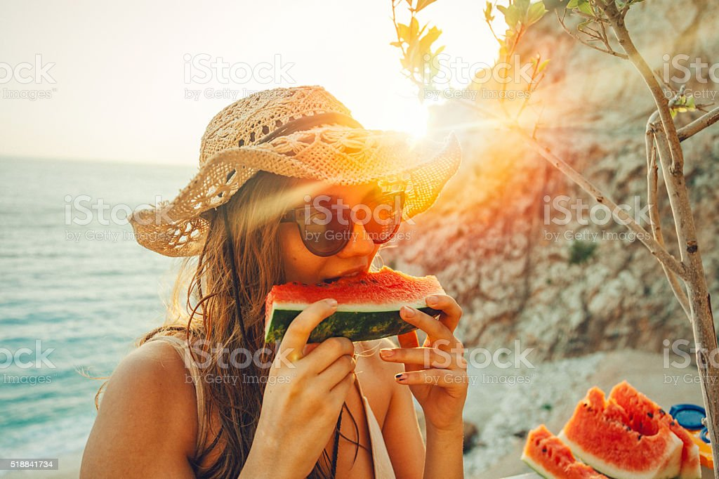Eating and enjoying watermelon stock photo