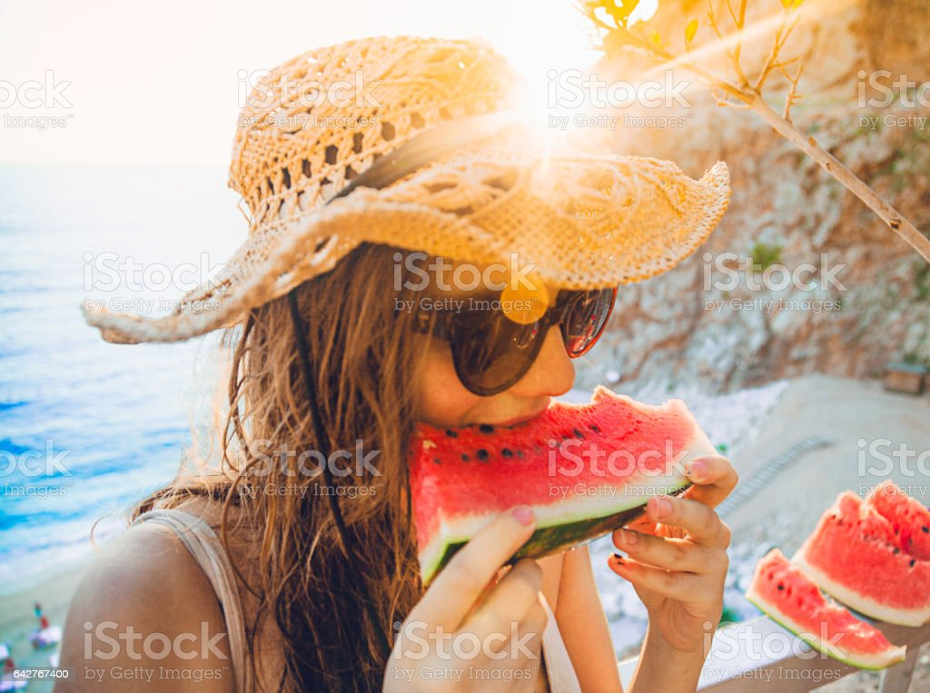 Eating and enjoying watermelon stock photo