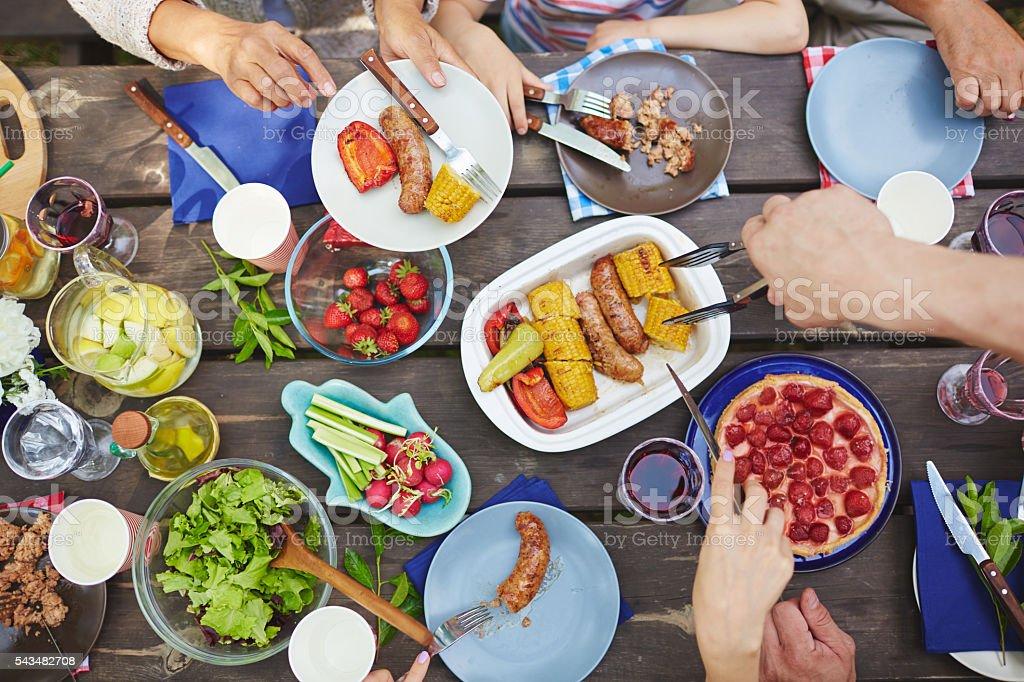 Eating at picnic stock photo