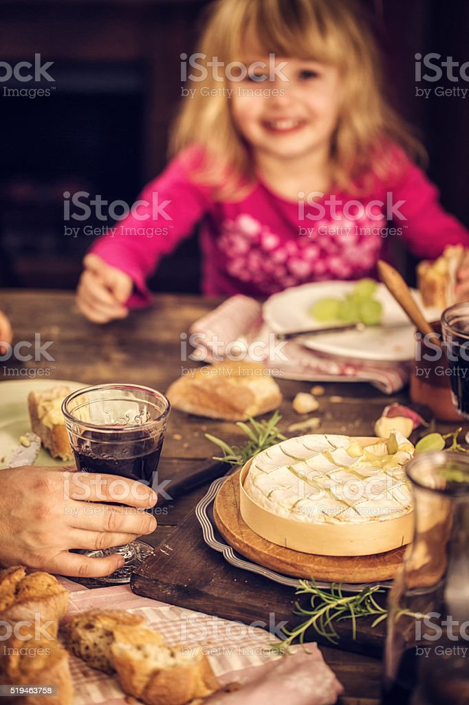 Eating Baked Creamy and Soft Camembert Cheese stock photo