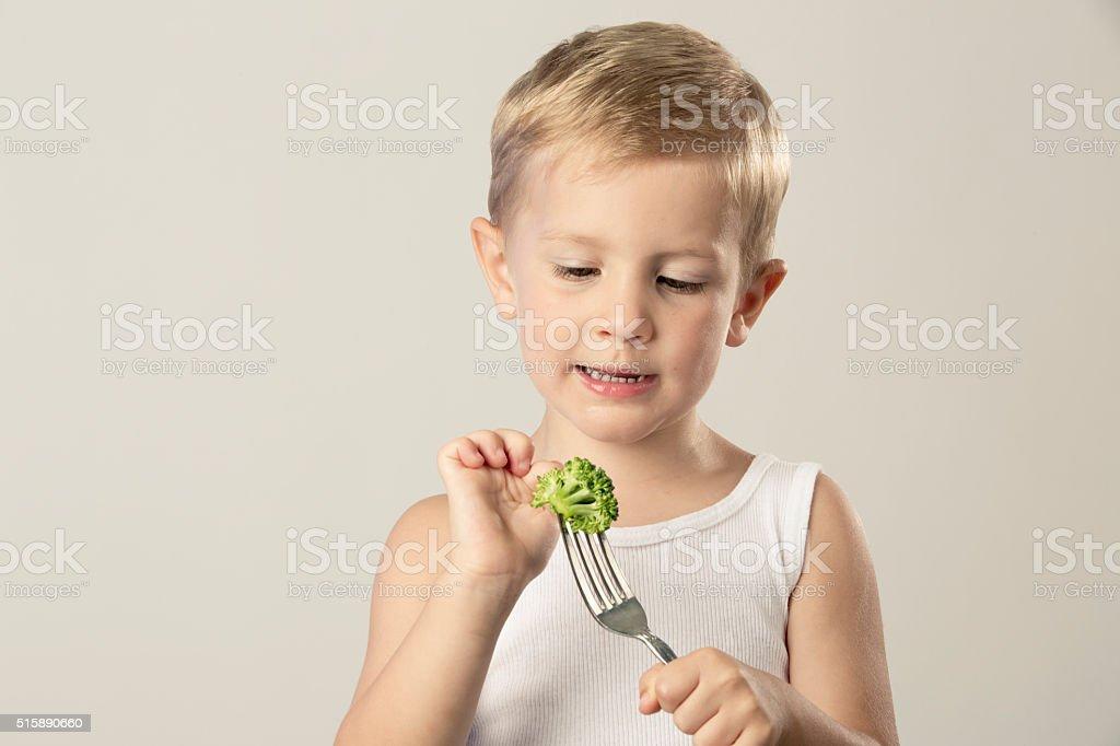Eating Broccoli stock photo