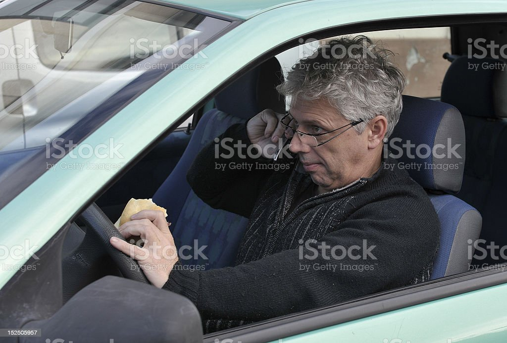 Eating, calling, driving stock photo