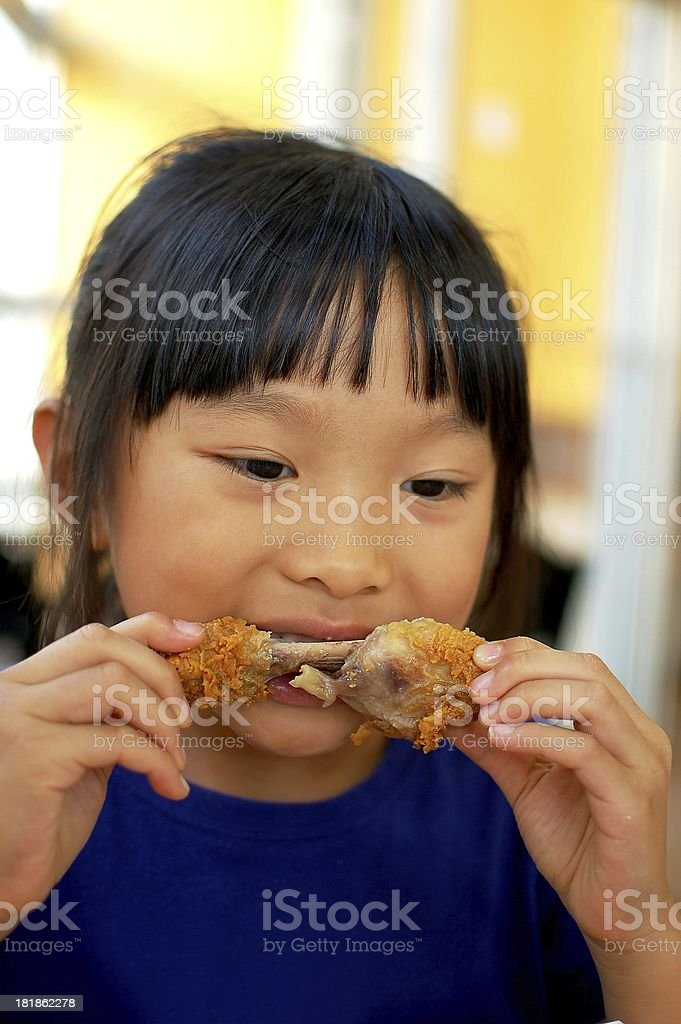 Eating chicken drumstick royalty-free stock photo