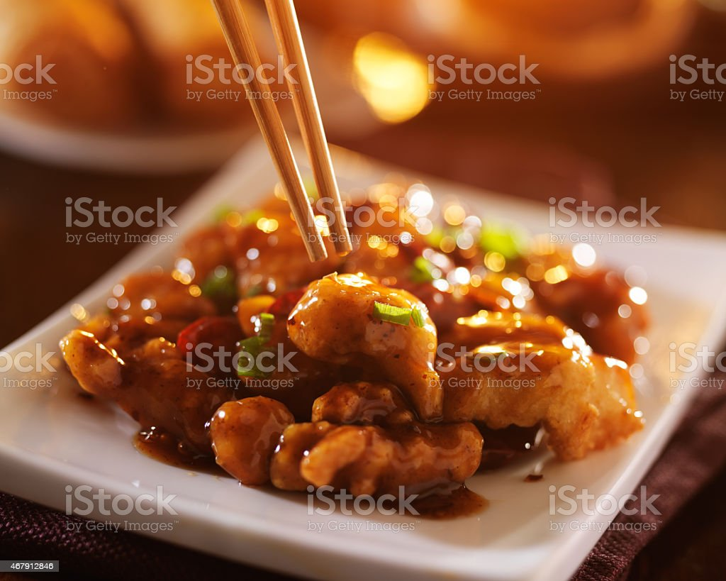 eating chinese food general tso's chicken stock photo