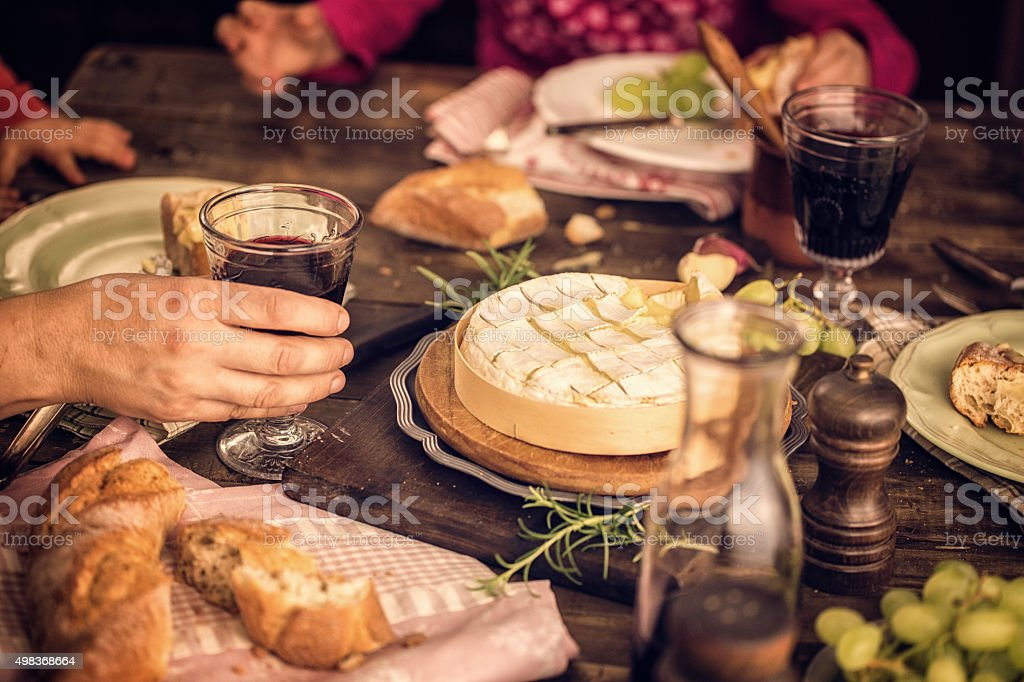 Eating Creamy and Soft Camembert Cheese stock photo