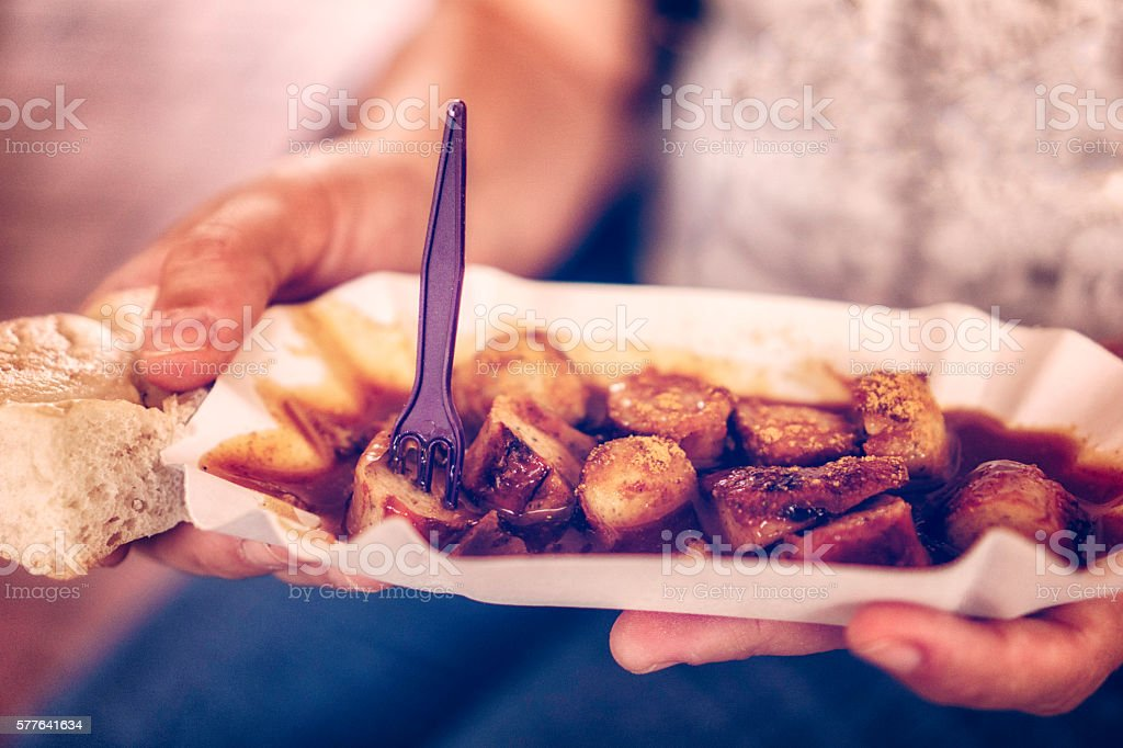 Eating Currywurt - Curried Sausage stock photo