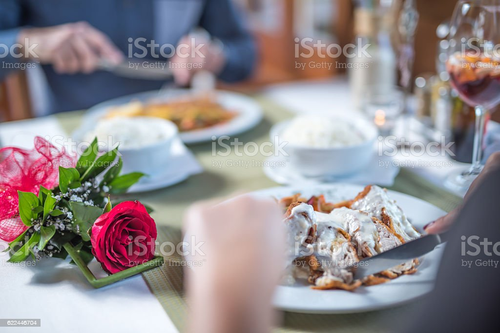 Eating delicious food on romantic meeting close up stock photo