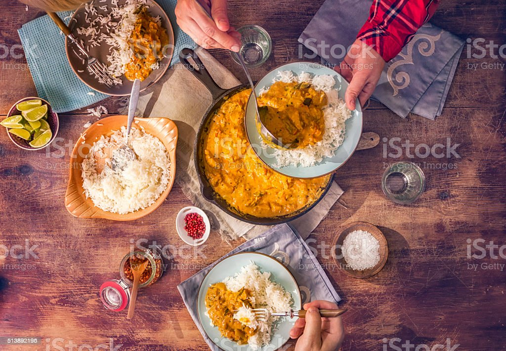 Eating Delicous Homemade Chicken Curry Dish with Rice stock photo