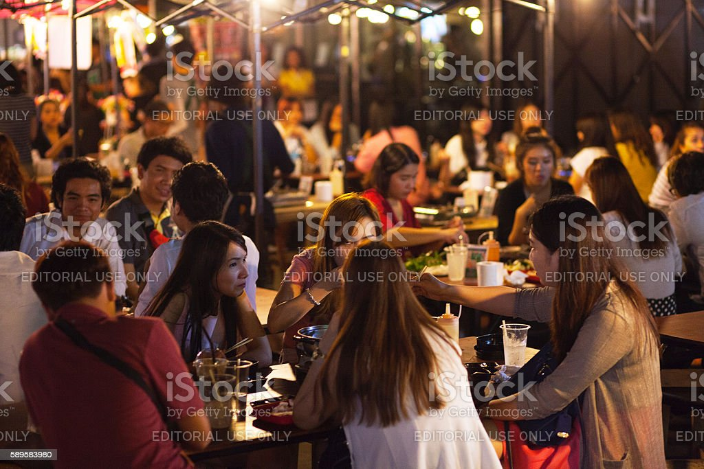 Eating, drinking and talking thai people stock photo