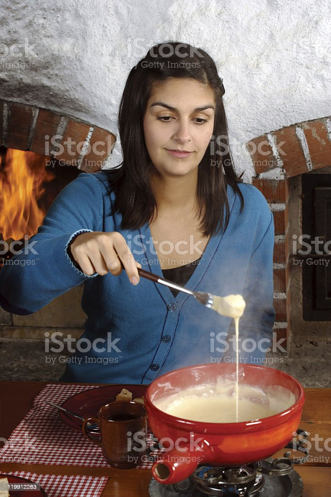 Eating fondue stock photo
