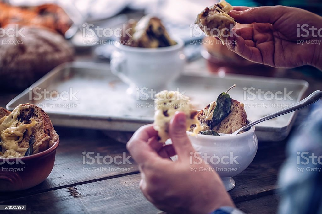 Eating French Onion Soup stock photo