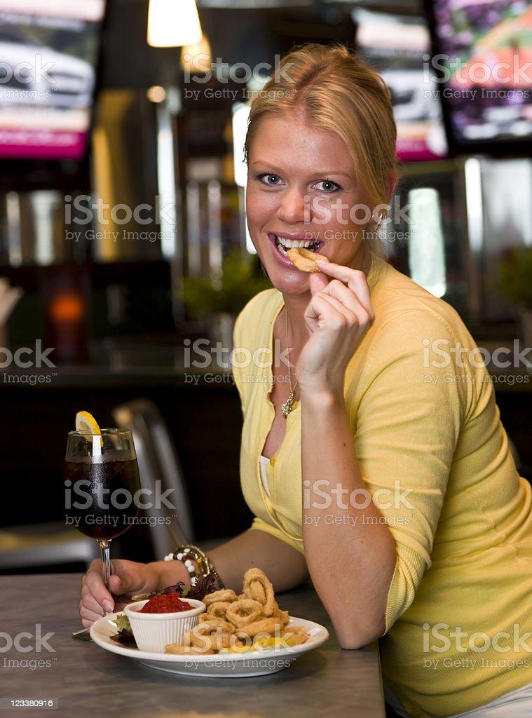 Eating fried calamari royalty-free stock photo