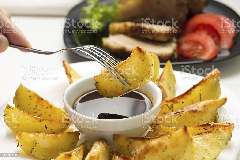 Eating Fried Wedge Potato royalty-free stock photo