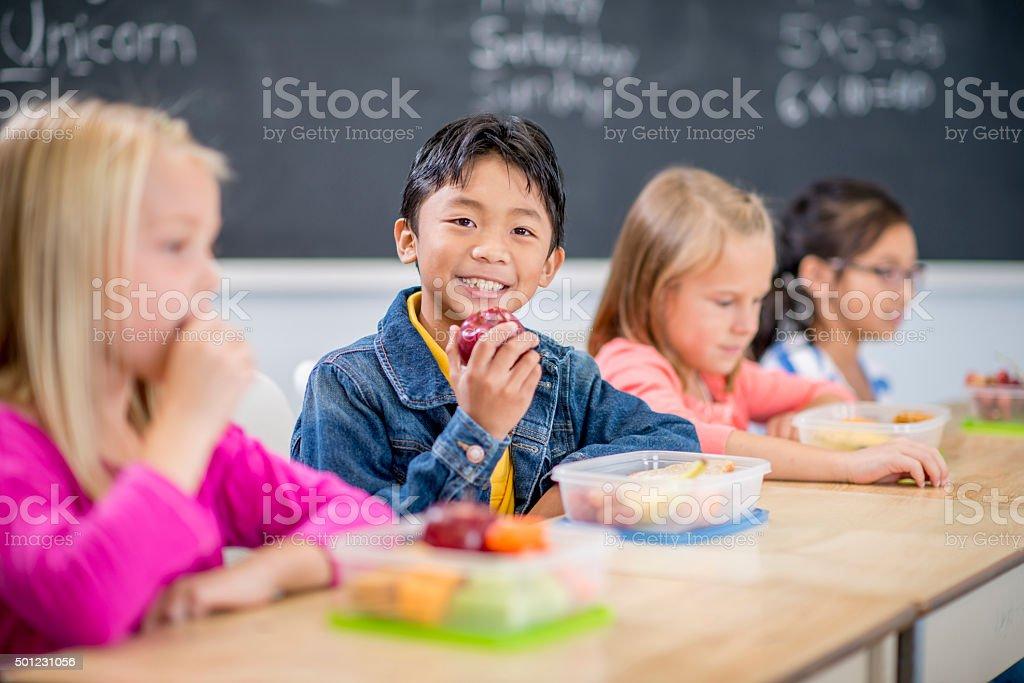 Eating Fruit for School Snacks stock photo
