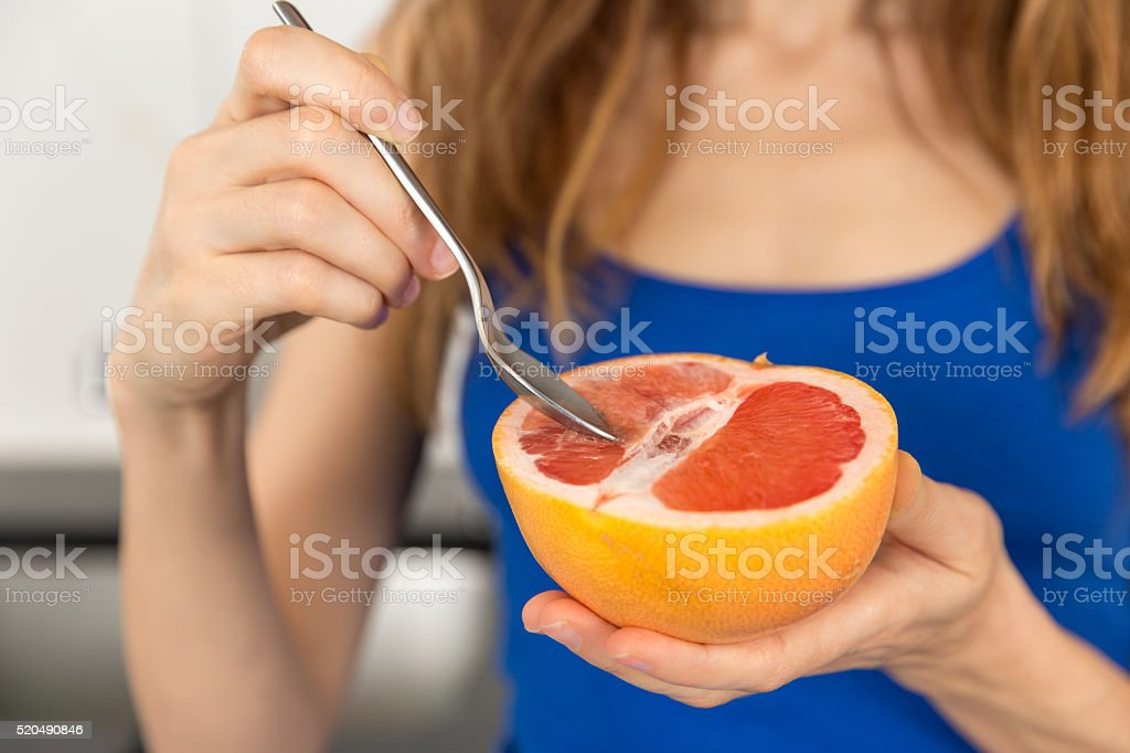 Eating fruit stock photo