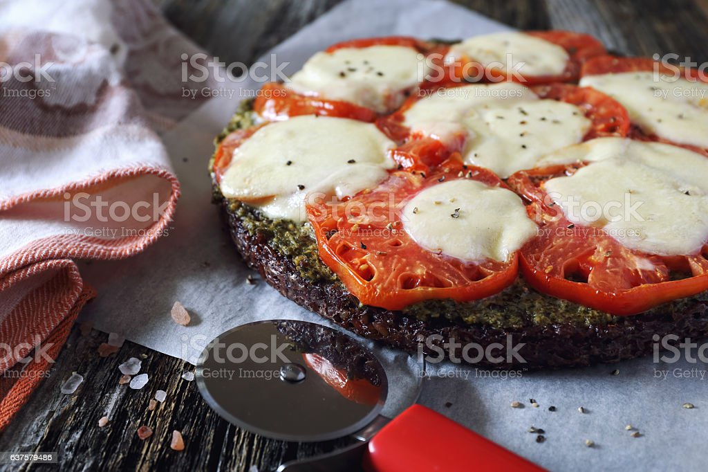 Eating gluten-free: pizza on a black rice stock photo