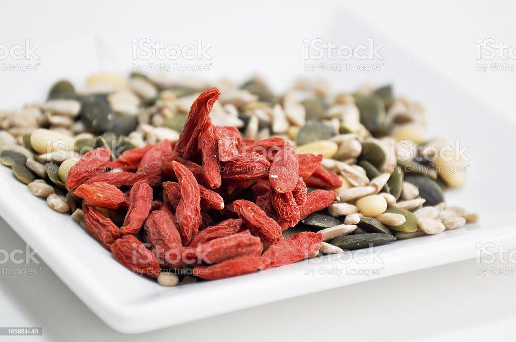 eating goji, pumpkin and sun flower seeds royalty-free stock photo