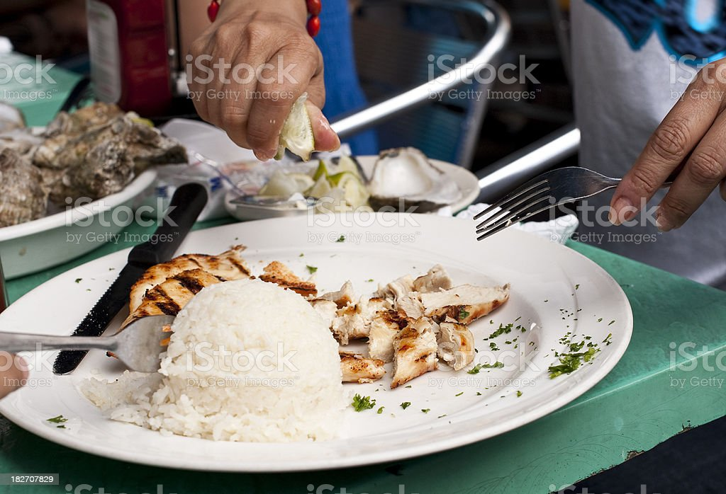 Eating grilled chicken royalty-free stock photo