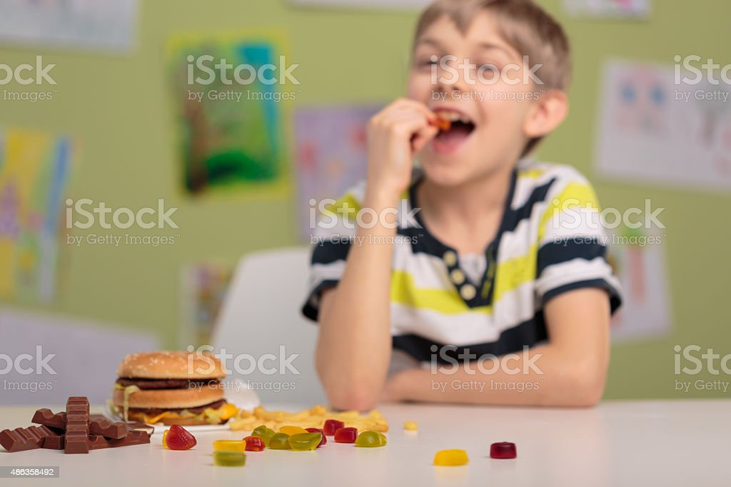Eating gummy bears at school stock photo