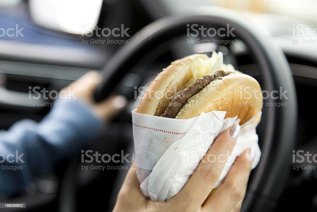 Eating Hamburger royalty-free stock photo