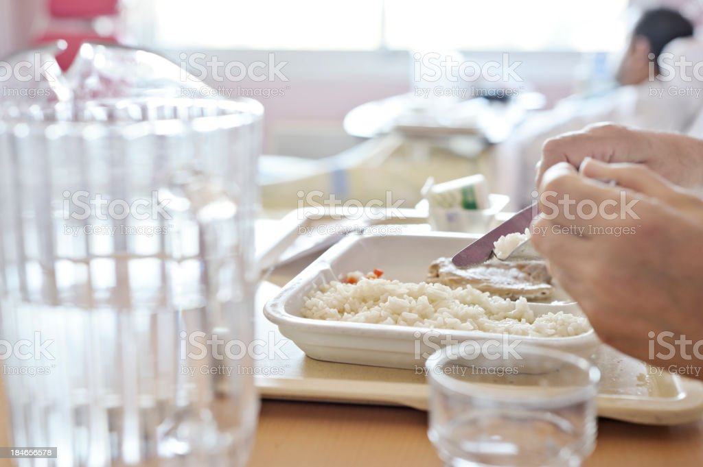 Eating hospital food portion stock photo