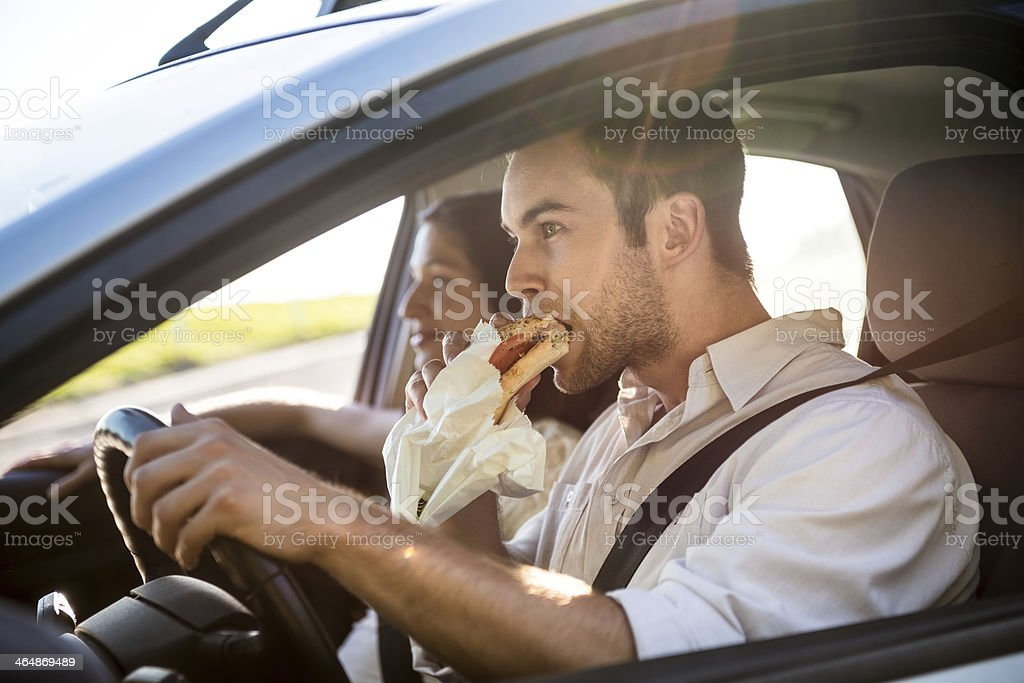 Eating in car royalty-free stock photo