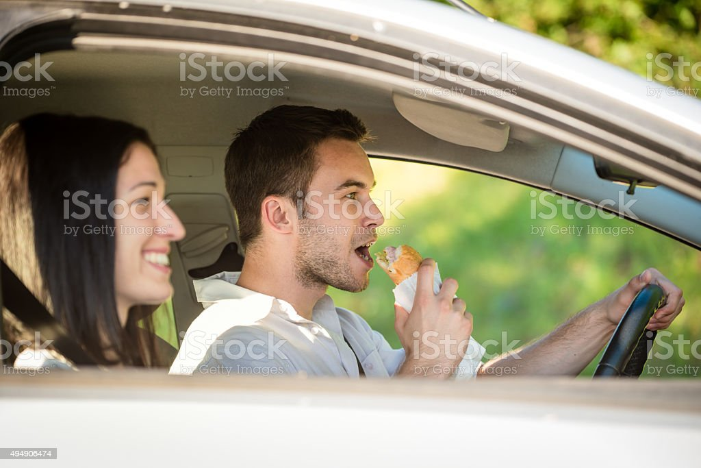 Eating in car stock photo