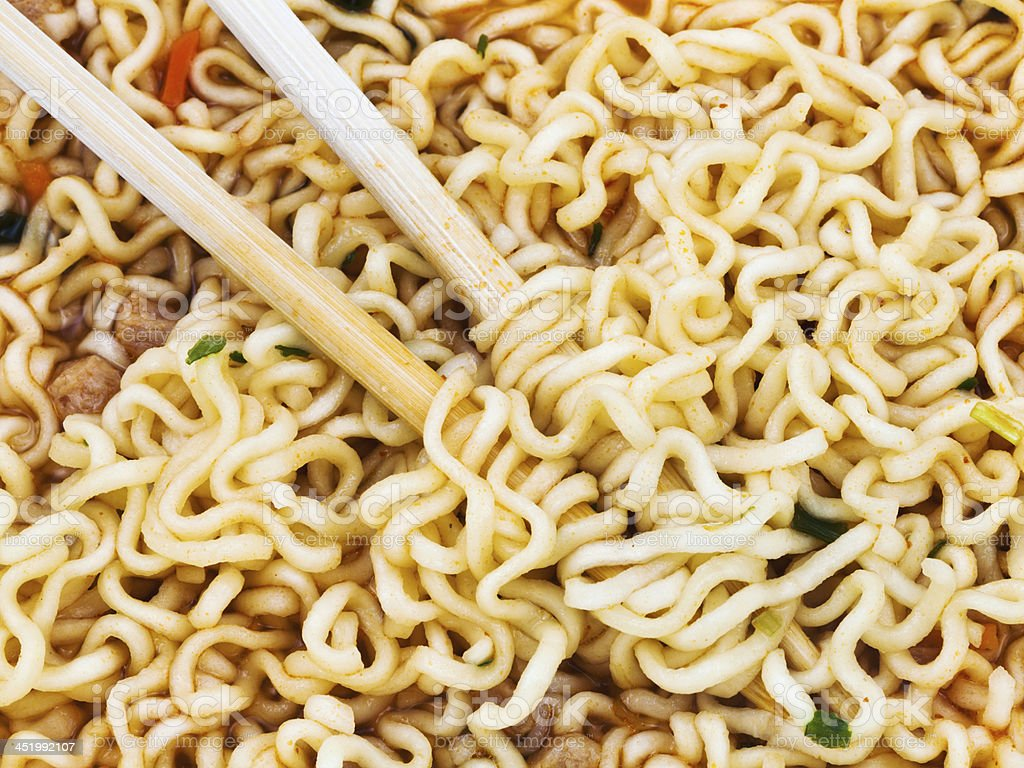eating instant noodles by wooden chopsticks royalty-free stock photo