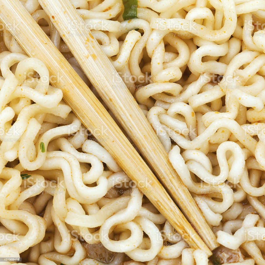 eating instant ramen by wooden chopsticks royalty-free stock photo