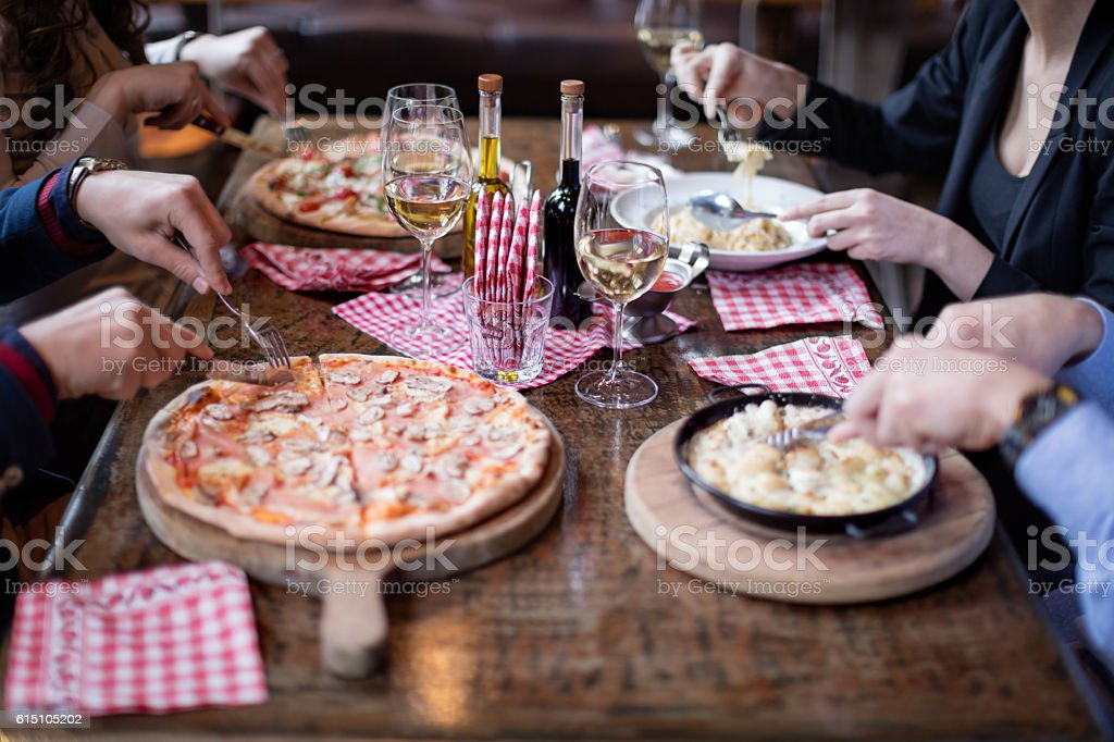 Eating italian food in restaurant stock photo
