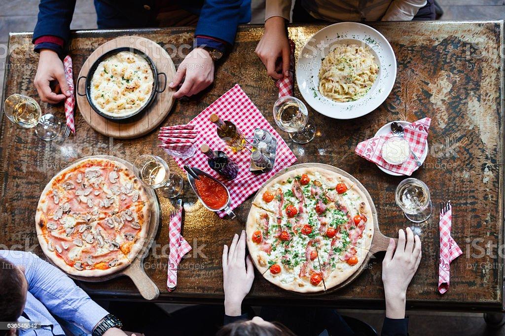 Eating italian food in restaurant stock photo