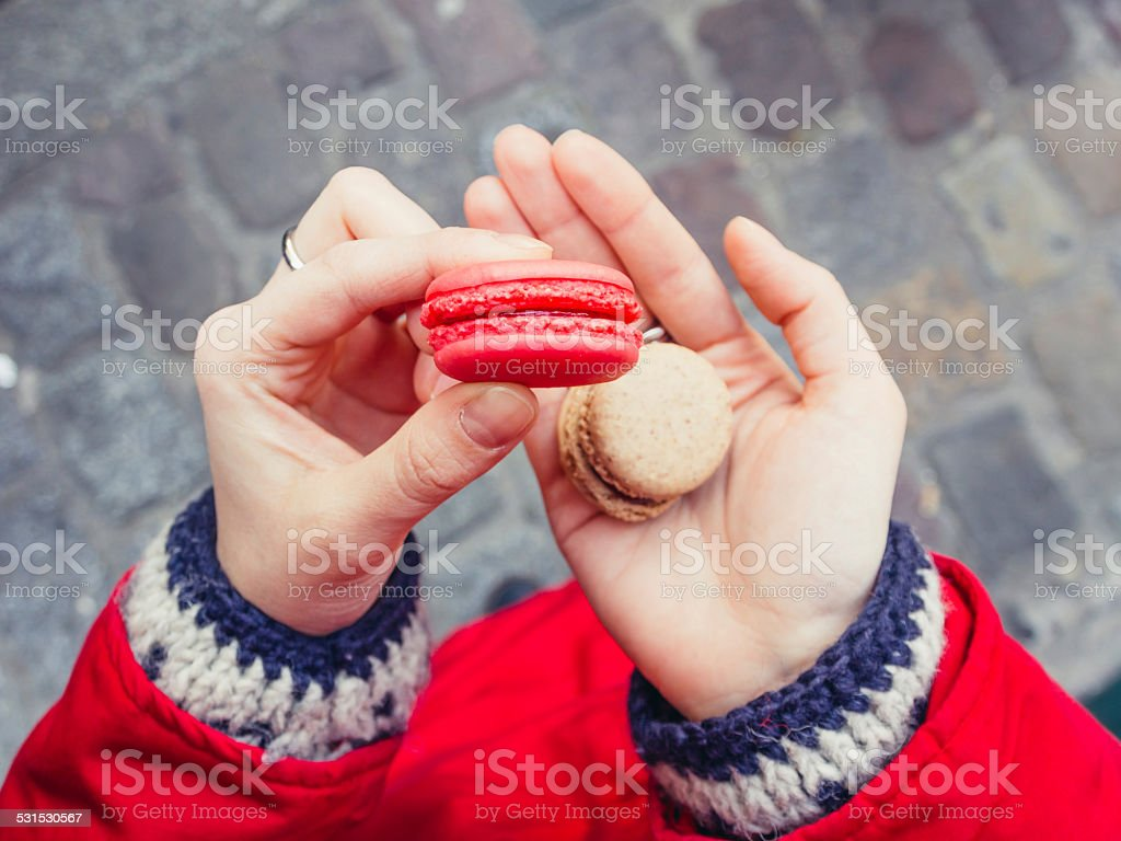 Eating Macarons stock photo
